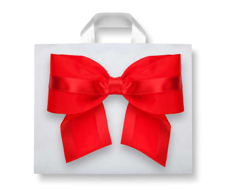 Plastic bag with red bow on white with shadow  photo