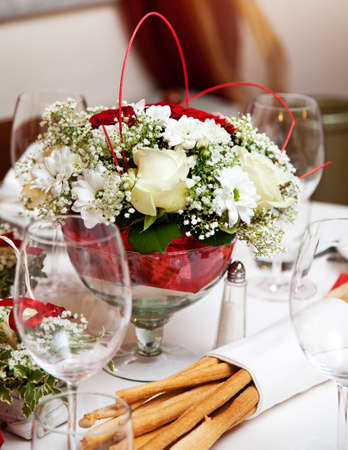 grissini: Banquet table setting with bouquet and grissini.