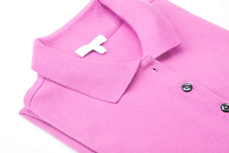 Detail of a pink polo shirt. photo
