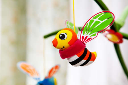 Hanging bees toy in baby room photo