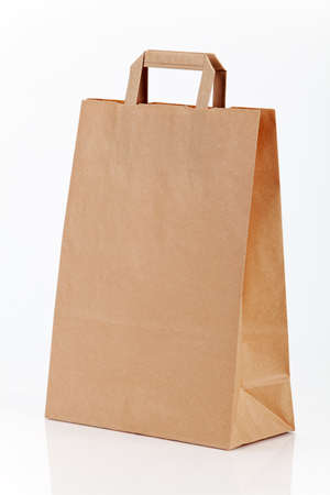 One paper shopping bag on white