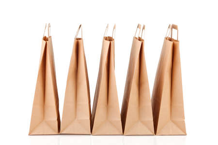 Several beige paper shopping bags. Stock Photo