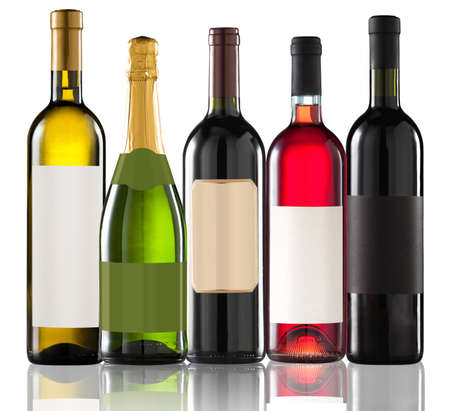 Group of five bottles on white