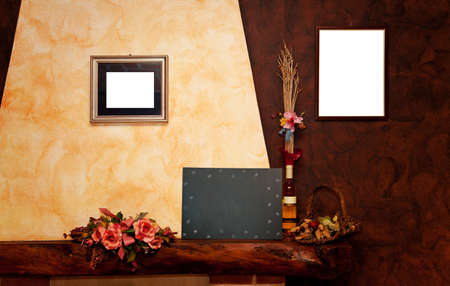 Two empty frames, a blackboard, a bottle,  on yellow and brown wall photo