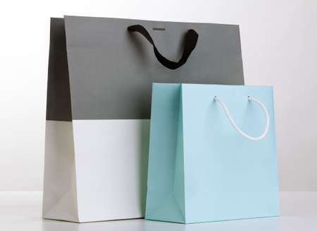 Two shopping bags on white.