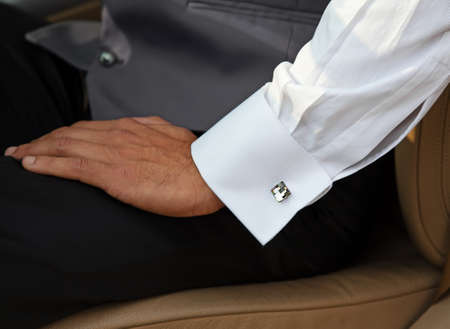 cufflink: Man with white shirt and cuff-link