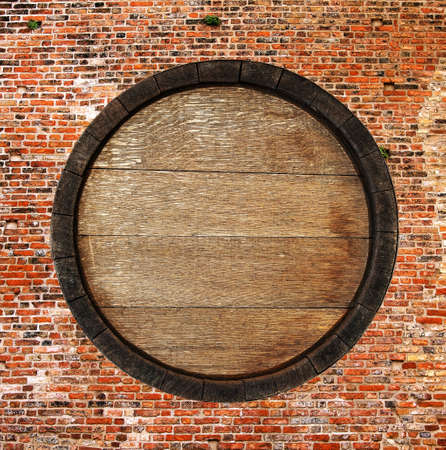 Old barrel isolated on old wall photo