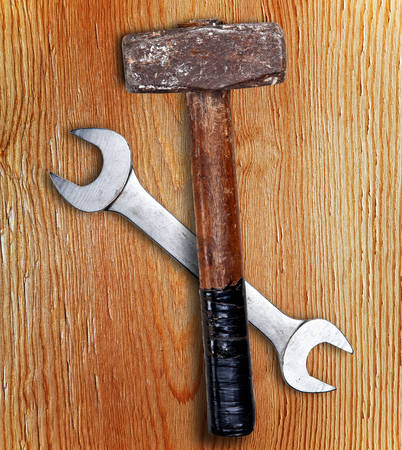 matallic: Hammer and wrench on wood with shadow
