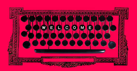 welcom: Welcom spelled on a vintage keyboard on red