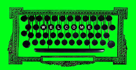 welcom: Welcom spelled on a vintage keyboard on green Stock Photo