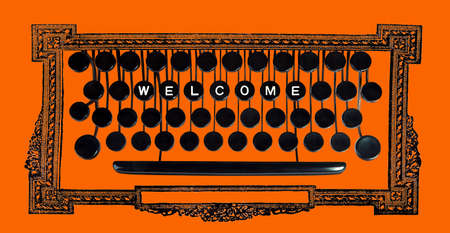 welcom: Welcom spelled on a vintage keyboard on orange Stock Photo