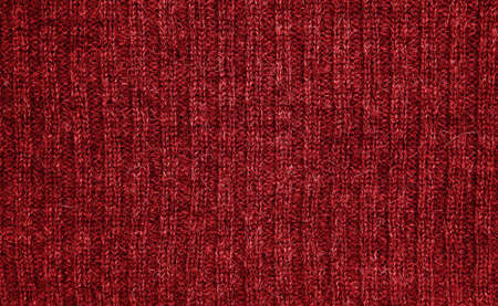 plain stitch: Background of red wool (detail of knitwear).