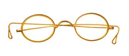 Old golden glasses on white