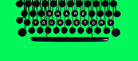 key words  art: Share your story spelled on a vintage keyboard on green