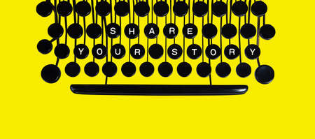 key words art: Share your story spelled on a vintage keyboard on yellow Stock Photo