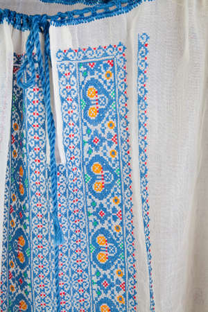 Blue embroidery on homemade blouse photo