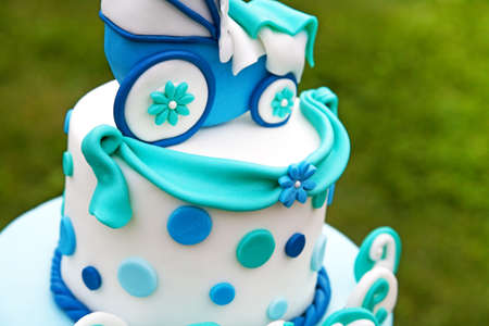 Detail of baby cake with blue and green ballons photo