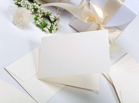 Blank wedding invitation with white decorations photo
