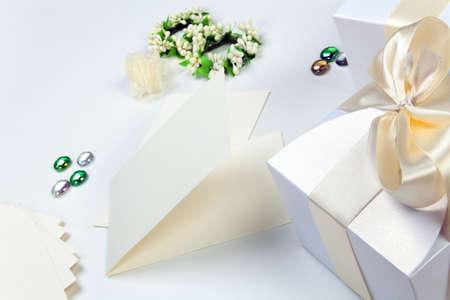 Blank wedding invitation with white boxes photo