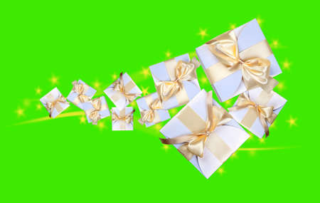 closed ribbon: White boxes with gold ribbon on green Stock Photo