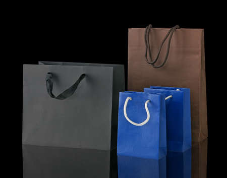 Several shopping bags isolated on black.