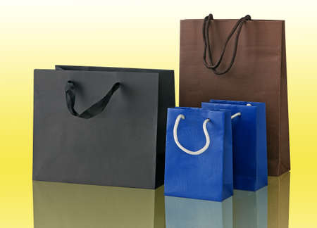 several: Several shopping bags isolated on yellow. Stock Photo