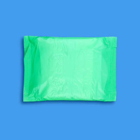 sanitary towel: Sanitary towel isolated on blue with shadow