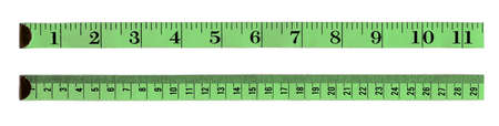 inches: Green rules, the first in inches, the second in centimeter Stock Photo