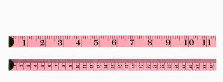 cintas metricas: Normas de color rosa, la primera en pulgadas, el segundo en cent�metros