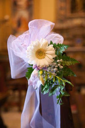 catholic wedding: Violet bow and daisy in Catholic Church bebore a wedding Stock Photo