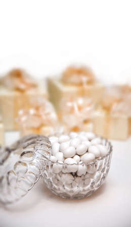Candies in a glass bowl, white background (wedding reception)