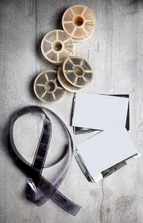 darkroom: White and black photographic film, blank photos, old photographic tools on grey background Stock Photo