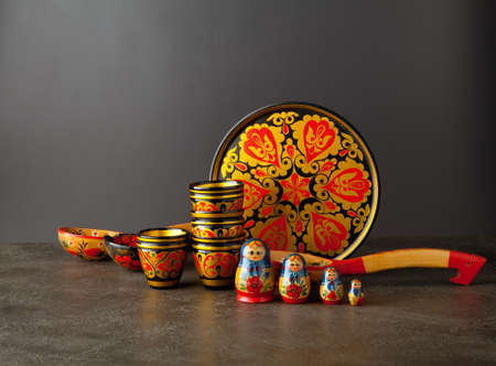 matryoshkas: Russian wood objects (spoons, plate, dolls and bowls) Stock Photo