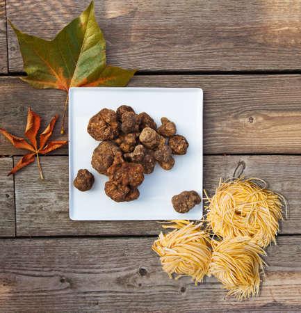Group of Italian white truffles and homemade pasta