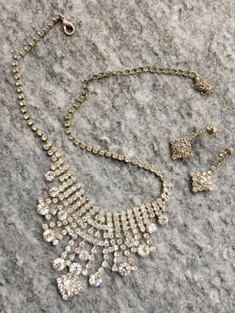 Costume jewerly: necklace and earrings on stone Stock Photo
