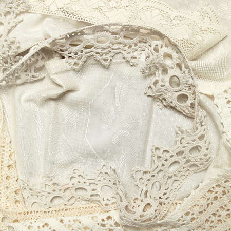 Old Style background: brocade or damask fabric with ancient laces. Imagens