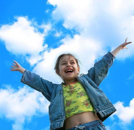 Little girl jumping of joy