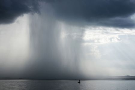 cloudburst: Thunderstorm cloudburst. The effective sky and lake Stock Photo