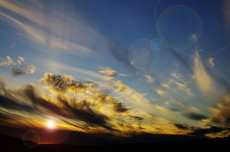 a vibrant sunset in the swirling clouds photo