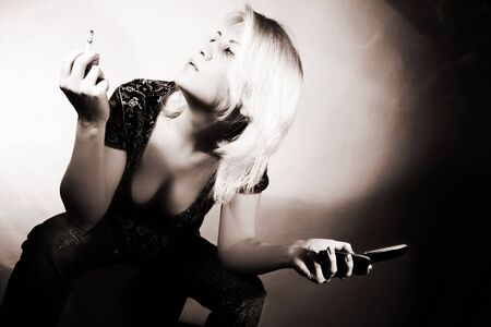 Fashion art photo. Beautiful woman with cigarette and phone photo
