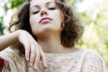 Portrait of beautiful woman on natures background photo