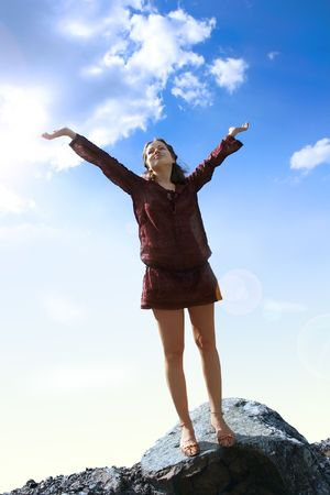 Happy woman with arms wide open Stock Photo