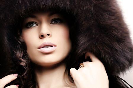 Beautiful woman. Winter fashion & makeup photo