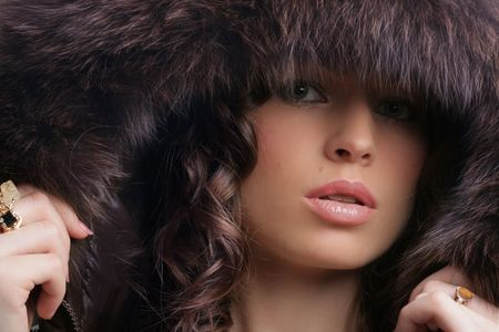 Beautiful woman. Winter fashion & makeup photo