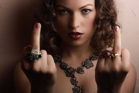 Beautiful woman showing middle fingers Stock Photo