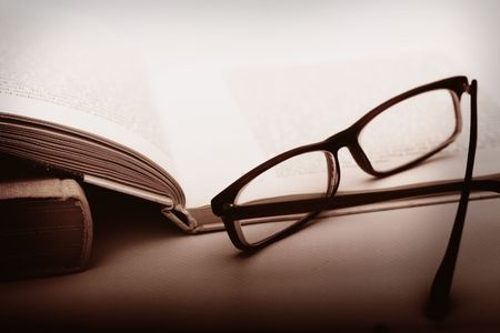 Book and Glasses. Vintage style photo