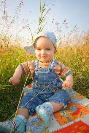 red jeans: beautiful baby in summer meadow