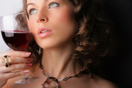 Portrait of beautiful woman with glass red wine photo