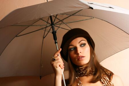 Glamour Girl With Umbrella. Fashion Photo photo