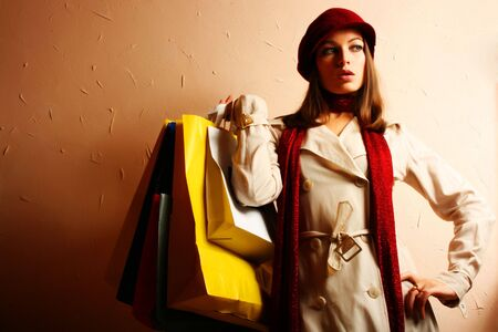 Portrait of young beautiful women with her shopping bags